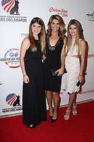 ***FILE PHOTO*** Lori Loughlin and husband, Mossimo Giannulli, will plead guilty to conspiracy charges in connection with securing  fraudulent admission of their two daughters.<br /> <br /> BEVERLY HILLS, CA - SEPTEMBER 27: Lori Loughlin and daughters at the Hero Dog Awards at the Beverly Hilton in Beverly Hills, CA on September 27, 2014. <br /> CAP/MPI/DE<br /> ©DE//MPI/Capital Pictures