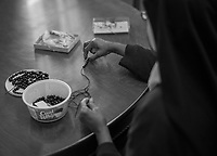 """Sister Jacinta makes rosaries out of beads to sell on Jan. 10, 2019. <br /> <br /> """"We make everything. Some sisters do crafts, like the rosaries and children's bracelets, which are sold in the front office,"""" says Mother Teresita. """"It's a lot to keep up, but it's not too big."""""""