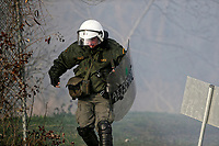 Pictured: A riot police officer takes cover. Sunday 01 March 2020<br /> Re: Clashes between migrants and riot police at the Greek-Turkish border of Kastanies near Evros, Greece