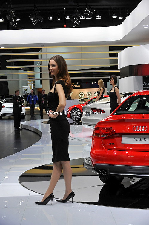A model poses in the Audi showroom at the Detroit Auto Show in Detroit, Michigan on January 12, 2009.