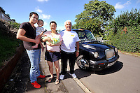 VIDEO AVAILABLE<br /> Pictured: Kai Huang holds his eldest son Tony and his partner Qiuxia Chen who gave birth to their son 'Loeo in the back of a Swansea taxi cab, pictured with cabby Steve Storton. Baby Loeo was born at 6.45 on Sunday evening  in Sketty, Swansea on their way to hospital.<br /> Re: When taxi driver Stephen Storton embarked on his evening shift, he didn't expect one of his customers to give birth in the back of his car.<br /> But that is exactly what happened when the Data Cabs driver picked up Chinese pair Kai Huang and Quix India.<br /> He said he had never seen anything like it after years working as a taxi driver.<br /> &quot;It came up on the computer that there was a taxi booked in Townhill for 6.30pm so off I went.<br /> &quot;When I got there a guy came out and said that his wife was in labor.<br /> &quot;When I was driving to the hospital she screamed that the baby was coming and that she could feel the head.<br /> &quot;I then pulled over by the side of Vivian Road in Sketty and the baby was born at 6.45pm.&quot;<br /> The baby's father Kai Huang described the moment he &quot;freaked out&quot; when his wife Quixia Chen gave birth to their son He said: &quot;I was really scary, I freaked out.<br /> &quot;My wife started experiencing some painful contractions so we phoned the hospital and they told us to get her to the hospital immediately.<br /> &quot;We then phoned a taxi and it arrived within five minutes.<br /> &quot;The baby came really quickly and half way to the hospital the driver had to pull over as the baby was born before the ambulance arrived.<br /> &quot;Both mother and baby are healthy now and the baby is called Loeo.&quot;
