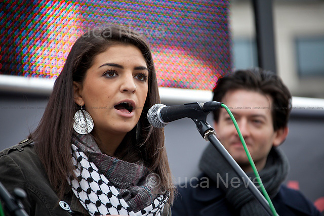 Sukri Sultan and Shadia Edwards-Dashti (Students Against The War).<br /> <br /> London, 08/10/2011. Today Trafalgar Square was the stage of the &quot;Antiwar Mass Assembly&quot; organised by The Stop The War Coalition to mark the 10th Anniversary of the invasion of Afghanistan. Thousands of people gathered in the square to listen to speeches given by journalists, activists, politicians, trade union leaders, MPs, ex-soldiers, relatives and parents of soldiers and civilians killed during the conflict, and to see the performances of actors, musicians, writers, filmmakers and artists. The speakers, among others, included: Jeremy Corbin, Joe Glenton, Seumas Milne, Brian Eno, Sukri Sultan and Shadia Edwards-Dashti, Hetty Bower, Mark Cambell, Sanum Ghafoor, Andrew Murray, Lauren Booth, Kate Hudson, Sami Ramadani, Yvone Ridley, Mark Rylance, Dave Randall, Roger Lloyd-Pack, Rebecca Thorn, Sanasino al Yemen, Elvis McGonagall, Lowkey (Kareem Dennis), Tony Benn, John Hilary, Bruce Kent, John Pilger, Billy Hayes, Alison Louise Kennedy, Joan Humpheries, Jemima Khan, Julian Assange, Lindsey German, George Galloway. At the end of the speeches a group of protesters marched toward Downing Street where after a peaceful occupation the police made some arrests.