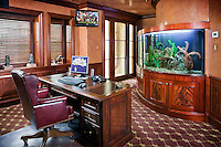 This high-tech home office has a built in aquarium, on-wall television and powerful computer.