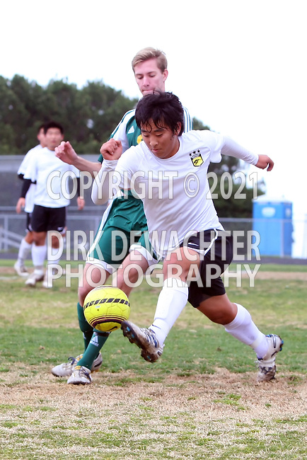 Palos Verdes, CA 02/07/12 - Michael Takeda (Peninsula #12) in action during the Mira Costa vs Peninsula Boys Varsity soccer bay league game.