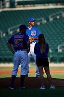 AZL Cubs 1 pitching coach Anderson Tavares (35) and trainer Hannah Balmaseda evaluate starting pitcher Benjamin Rodriguez (70) during an Arizona League game against the AZL Padres 1 on July 5, 2019 at Sloan Park in Mesa, Arizona. The AZL Cubs 1 defeated the AZL Padres 1 9-3. (Zachary Lucy/Four Seam Images)