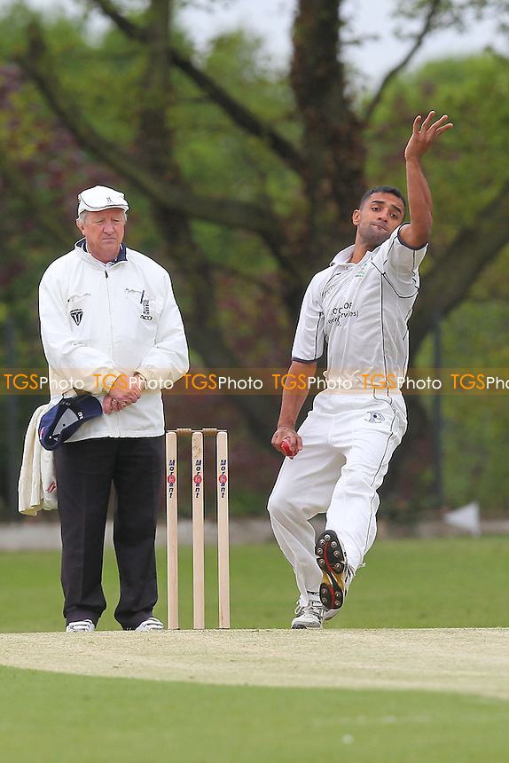 Z Shahzad in bowling action for Wanstead - Wanstead CC vs Buckhurst Hill CC - Essex Cricket League at Overton Drive - 11/05/13 - MANDATORY CREDIT: Gavin Ellis/TGSPHOTO - Self billing applies where appropriate - 0845 094 6026 - contact@tgsphoto.co.uk - NO UNPAID USE.