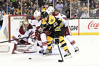 March 13, 2014 - Boston, Massachusetts , U.S. -  Boston Bruins center Chris Kelly (23) and Phoenix Coyotes defenseman Oliver Ekman-Larsson (23) both work in front of goalie Mike Smith (41) during the NHL game between the Phoenix Coyotes and the Boston Bruins held at TD Garden in Boston Massachusetts. The Bruins defeated the Coyotes 2-1 in regulation time. Eric Canha/CSM