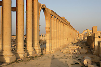 Great Colonnade, along the Cardo Maximus or main street, 1.2 kms in length with porticoes at each end, 2nd century AD, Palmyra, Syria. Agora entrance in foreground. In Roman city-planning, the Cardo Maximus runs north-south, intersecting with the east-west Decumanus Maximus Picture by Manuel Cohen