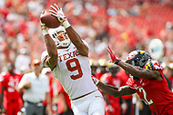 Landover, MD - September 1, 2018: Texas Longhorns wide receiver Collin Johnson (9) catches pass during the game between Texas and Maryland at  FedEx Field in Landover, MD.  (Photo by Elliott Brown/Media Images International)
