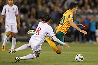 MELBOURNE, 11 JUNE 2013 - Tomas ROGIC of Australia is tackled by Mohammad MUSTAFA of Jordan in a Round 4 FIFA 2014 World Cup qualifier match between Australia and Jordan at Etihad Stadium, Melbourne, Australia. Photo Sydney Low for Zumapress Inc. Please visit zumapress.com for editorial licensing. *This image is NOT FOR SALE via this web site.