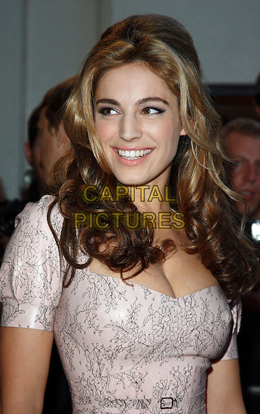 KELLY BROOK.GQ Men Of The Year Awards held at the Royal Opera House, Covent Garden, London, England. .September 8th 2009.headshot portrait curly wavy hair cleavage pale pink grey gray print floral .CAP/ROS.©Steve Ross/Capital Pictures.