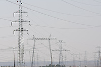 Electric power transmission lines are seen near the nuclear power plant in Paks, 120 km (75 miles) east of Budapest, Hungary on March 23, 2011. ATTILA VOLGYI