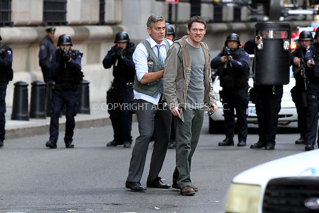 WWW.ACEPIXS.COM<br /> <br /> April 12 2015, New York City<br /> <br /> Actors George Clooney and Jack O'Connell were on the downtown set of the new movie 'Money Monster' on April 12 2015 in New York City<br /> <br /> By Line: Nancy Rivera/ACE Pictures<br /> <br /> <br /> ACE Pictures, Inc.<br /> tel: 646 769 0430<br /> Email: info@acepixs.com<br /> www.acepixs.com