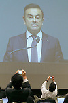 Members of the media take pictures whilst Nissan Chairman and CEO Carlos Ghosn speaks during an extraordinary stockholders meeting at Makuhari Messe on December 14, 2016, in Makuhari, Japan. Mitsubishi Motors approved the implementation of a new management structure based on their alliance with Renault-Nissan. Ghosn, who is now also Chairman of MMC, also attended the meeting. Nissan is Mitsubishi Motors largest shareholder holding 34%. (Photo by Rodrigo Reyes Marin/AFLO)