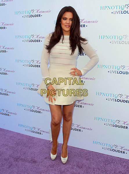 Khloe Kardashian Odom.Khloe Kardashian Odom/HPNOTIQ Harmonie Cocktail Recipe Launch.Held at A Mr. C Beverly Hills, Beverly Hills, California, USA..August 2nd, 2012.full length white cream dress sheer hand on hip striped stripes  top skirt.CAP/ADM/KB.©Kevan Brooks/AdMedia/Capital Pictures.
