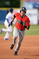 Birmingham Barons outfielder Trayce Thompson (21) runs the bases during a game against the Chattanooga Lookouts on April 24, 2014 at AT&T Field in Chattanooga, Tennessee.  Chattanooga defeated Birmingham 5-4.  (Mike Janes/Four Seam Images)