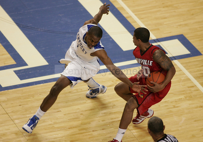 Sophomore guard Darius Miller guards Louisville's Edgar Sosa in the first half of the UK men's basketball game against Louisville at Rupp Arena on Saturday, Jan. 2, 2010. The Cats lead the Cardinals 27-19 at halftime. Photo by Adam Wolffbrandt   Staff
