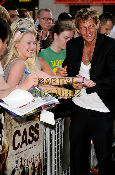 "LEO GREGORY.UK Film Premiere of ""Cass"" held at the Empire cinema , Leicester Square, London, England. .July 28th 2008.half 3/4 length suit fans crowd signing autographs black white top.CAP/CAN.©Can Nguyen/Capital Pictures."