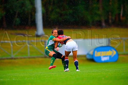 23.08.2015. Dublin, Ireland. Women's Sevens Series Qualifier 2015. Brazil versus Hong Kong<br /> Juliana Silva (Brazil) tackles Pak Yan Poon (Hong Kong).