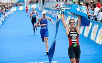 15 AUG 2009 - LONDON, GBR - Nicola Spirig celebrates winning the ITU World Championship Series Womens Triathlon ahead of Lisa Norden and Helen Jenkins (PHOTO (C) NIGEL FARROW)