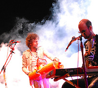 Lead Wayne Coyne controls the pyrotechnics (left) as Michael Ivins plays bass (right) at the Flaming Lips concert at the Alliant Energy Center's Willow Island Saturday night, 9/8/07, in Madison, Wisconsin