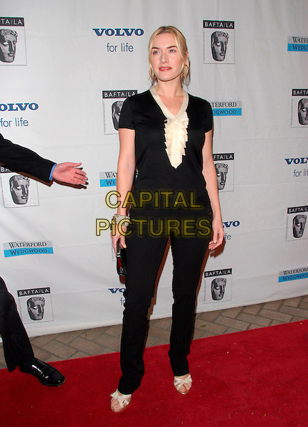 KATE WINSLET.Attends The BAFTA/LA Awards Season Tea Party held at The Four Season's Hotel in Los Angeles, California, USA, January 14 2007..full length gold hoop earrings black and cream white ruffle collar top skinny jeans bracelet cuff bangle sandals shoes.CAP/DVS.©Debbie VanStory/Capital Pictures