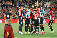Athletic de Bilbao's players celebrate the victory in the Supercup of Spain in rpesence of  FC Barcelona's Sandro Ramirez dejected. August 17,2015. (ALTERPHOTOS/Acero)