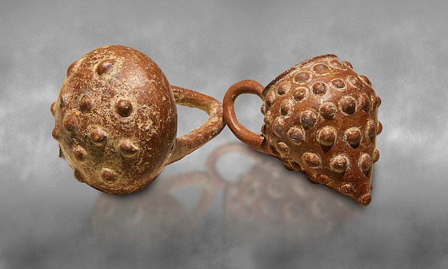 Bronze Age Anatolian terra cotta basket with handle & a beaker shaped as a bunch of grapes - 19th to 17th century BC - Kültepe Kanesh - Museum of Anatolian Civilisations, Ankara, Turkey.