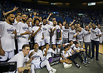 The Nevada team celebrates with the Mountain West Championship trophy after their win over San Diego State in an NCAA college basketball game in Reno, Nev., Saturday, March 9, 2019. (AP Photo/Tom R. Smedes)