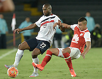 BOGOTÁ-COLOMBIA-16-02-2016: Juan D Roa (Der) jugador de Independiente Santa Fe de Colombia disputa el balón con Luis Leal (Izq) jugador de Cerro Porteño de Paraguay, durante partido de la fecha 1 por la segunda fase, llave G8, de la Copa Bridgestone Libertadores 2016 jugado en el estadio Nemesio Camacho El Campin de la ciudad de Bogotá. / Juan D Roa (R) player of Independiente Santa Fe of Colombia fights for the ball with Luis Leal (L) player of Cerro Porteño of Paraguay during the match of the date 1 for the second phase, G8 key, of the Copa Bridgestone Libertadores 2016 played at Nemesio Camacho El Campin stadium in Bogota city.  Photo: VizzorImage/ Gabriel Aponte /Staff