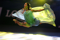 Irina Tchachina of Russia performs split leap handsfree with chiffon during gala at finish of World Championships in Baku, Azerbaijan on October 9, 2005. (Photo by Tom Theobald)..(Photo notes... With 400mm from favorite position during last days of WC.  Gala started and they had no spotlight man holding a beam on Irina!  Instead were some ummmmm, disco lights revolving for like a stadium rock & roll show.  By then I was just so tired and whatever, just do anything, get some kind of an image.  I went up to ASA 1600 @ 250th/f2.8 and prayed something nice would happen.  Come what may...)