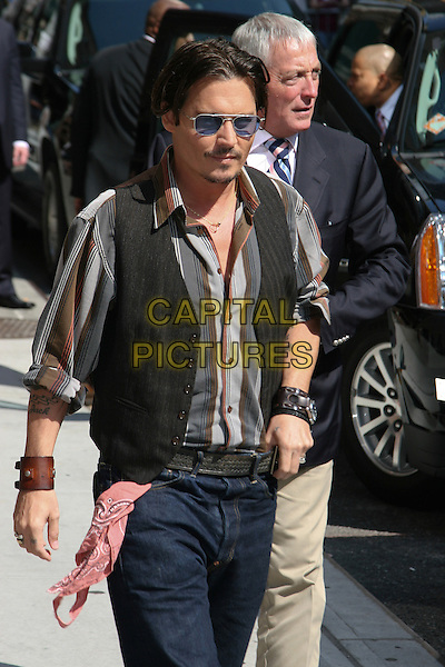 "JOHNNY DEPP.Appearance on the ""Late Show with David Letterman"" at the Ed Sullivan Theater, New York, NY, USA..June 25th, 2009.half length jeans denim black waistcoat brown grey gray striped stripes shirt sunglasses shades hankerchief in pocket leather cuffs bracelets tattoo goatee facial hair .CAP/LNC/TOM.©TOM/LNC/Capital Pictures."
