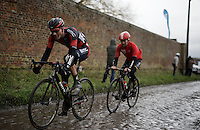 Loic Vliegen (BEL/BMC) & Sean De Bie (BEL/Lotto-Soudal) racing hard over the wet cobbles<br /> <br /> GP Samyn 2016