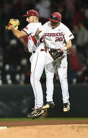 NWA Democrat-Gazette/ANDY SHUPE<br />Arkansas first baseman Chad Spanberger (left) and third baseman Carson Shaddy celebrate their 3-1 win over Mississippi State Friday, March 17, 2017, at Baum Stadium in Fayetteville. Visit nwadg.com/photos to see more photographs from the game.