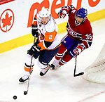 26 October 2009: New York Islanders' defenseman Mark Streit is shadowed by Montreal Canadiens right wing forward Matt D'Agostini during the first period at the Bell Centre in Montreal, Quebec, Canada. The Canadiens defeated the Islanders 3-2 in sudden death overtime for their 4th consecutive win. Mandatory Credit: Ed Wolfstein Photo