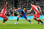 Philippe Coutinho of FC Barcelona (C) fights for the ball with Farid Boulaya of Girona FC (L) and Alex Granell Nogue of Girona FC (R) during the La Liga 2017-18 match between FC Barcelona and Girona FC at Camp Nou on 24 February 2018 in Barcelona, Spain. Photo by Vicens Gimenez / Power Sport Images