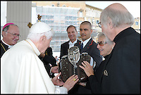 BNPS.co.uk (01202 558833)<br /> Pic: Bonhams/BNPS<br /> <br /> ***Please Use Full Byline***<br /> <br /> Pope Benedict being presented with the Harleys fuel tank.<br /> <br /> Holy Davidson - Twin Pope.<br /> <br /> A unique and historic motorbike is being sold by Bonhams next month -  A Harley Davidson Softail Classic that carries the signature of Pope Benedict XVI, and was later presented to his successor Pope Francis. <br /> <br /> The Papal abdication makes this stunning machine historically unique and despite its &pound;20,000 estimate bidding is likely to be fierce.<br /> <br /> This most holy of Harley's is unlikely to attract much interest from the famous American brands most loyal fans though - Hells Angels.<br /> <br /> Bonhams 5th Feb - Paris - Est &pound;20,000