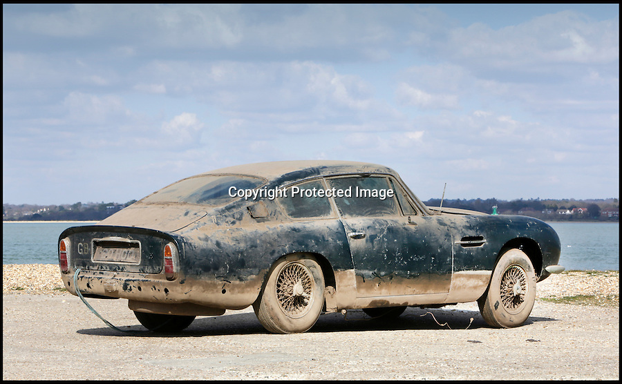 BNPS.co.uk (01202 558833).Pic: Bonhams/BNPS..***Please Use Full Byline***..It may look like its run the gautlet with every Bond villain in movie history...but this classic Aston Martin would be worth a whopping £150,000 if restored to pristine condition. ..The 1966 DB6 Vantage was last purchased for only £4000 in the early seventies but sadly its owner locked it away in a very dusty barn in 1983 where the iconic motor has spent the last 30 years languishing under a thick layer of dust...Despite its rather tired appearance Bonhams are hoping to sell it for upwards of £30,000...and its first outing will be straight to the car wash...