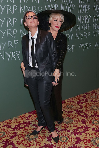 """NEW YORK, NY - OCTOBER 31 : Actress Bette Midler (R) and Guest arrive for the New York Restoration Project's 19th Annual Hulaween Gala """"FELLINI HULAWEENI"""" held at the Waldorf Astoria on October 31, 2014 in New York City.  (Photo by Brent N. Clarke / MediaPunch)"""