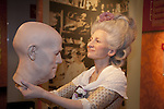 A wax figure of Madame Tussaud holding a wax head at Madame Tussauds Hollywood, Los Angeles, CA