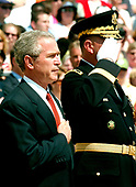 Washington, D.C. - May 29, 2006 -- United States President George W. Bush and Commandant of the Military District of Washington (MDW) Major General Guy C. Swann III participate in a wreath laying ceremony at the Tomb of the Unknowns at Arlington National Cemetery in Arlington, Virginia  by the on May 29, 2006.  The President and first lady were at Arlington for the annual Memorial Day Commemoration honoring fallen American heroes.<br /> Credit: Ron Sachs  - Pool via CNP