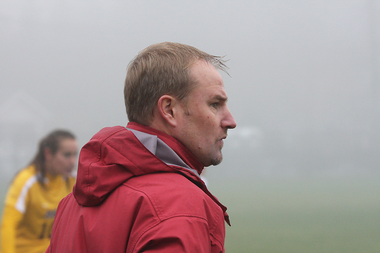 Matt Potter, Washington State University Head Women's Soccer Coach, watches nervously through the fog as his Cougars went in to double overtime during their match with the Arizona State Sun Devils in Pullman, Washington, on November 9, 2008.  The Cougars needed a victory for a chance at an NCAA bid and they finally prevailed, 1-0, on a dramatic goal by Elysse Van Leer in the second overtime.