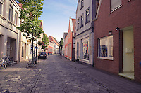 Street of typical small German town Warendorf, empty brick street.