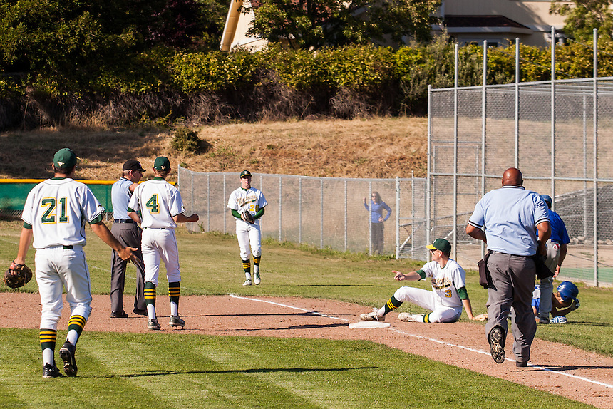 San Marin second baseman Chris Glennon collides with Acalanes baserunner Paul Nork during the North Coast Section Division 3 final at San Marin High School on June 6, 2011. Novato Fire District officers took Nork to a local hospital. The game ended in a 4-4 time after officials suspended the game due to darkness after 10 innings. NCS officials declared both teams Co-champions.