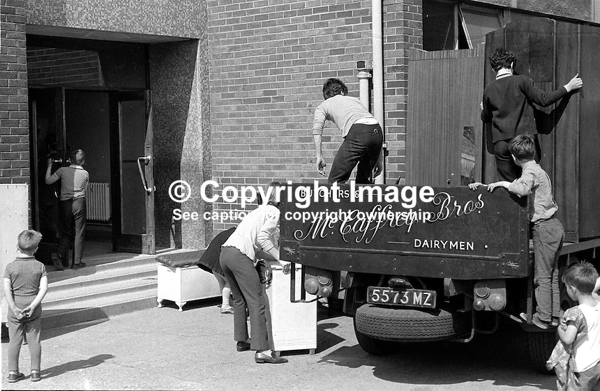 Roman Catholic families evacuating from Chief Street, Belfast, N Ireland, UK, because of continuing rioting off-load their belongings at a local school where they are being put up until the situation improves. 197006000225c..Copyright Image from Victor Patterson, 54 Dorchester Park, Belfast, UK, BT9 6RJ..Tel: +44 28 9066 1296.Mob: +44 7802 353836.Voicemail +44 20 8816 7153.Skype: victorpattersonbelfast.Email: victorpatterson@me.com.Email: victorpatterson@ireland.com (back-up)..IMPORTANT: If you wish to use this image or any other of my images please go to www.victorpatterson.com and click on the Terms & Conditions. Then contact me by email or phone with the reference number(s) of the image(s) concerned.