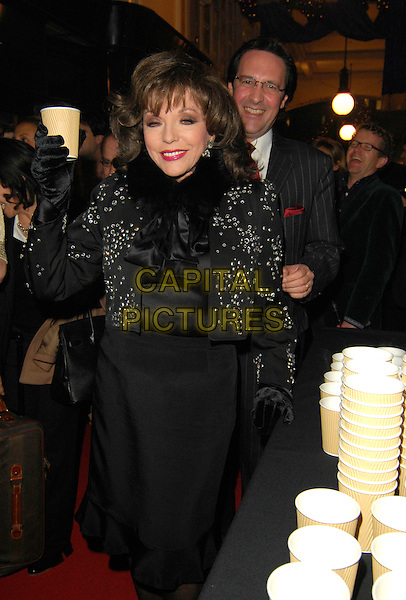 JOAN COLLINS .Switches on the Burlington Arcade Christmas Lights, Burlington Arcade, Piccadilly, London, England,.November 20th 2007..xmas half length black studded jacket top holding cup drink funny eyes shut.CAP/CAN.©Can Nguyen/Capital Pictures