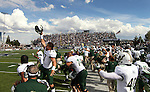 South Florida players celebrate after coming from behind to beat Nevada 32-31 in an NCAA college football game Saturday, Sept. 8, 2012, in Reno, Nev. (AP Photo/Cathleen Allison)