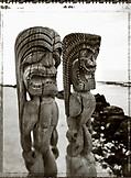 USA, Hawaii, The Big Island, Kona, totem statues stand at the sacred site called Pu'uhonya O Honaunau (B&W)