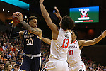 02 January 2016: Notre Dame's Zach Auguste (30) is defended by Virginia's Anthony Gill (13) and Isaiah Wilkins (21). The University of Virginia Cavaliers hosted the University of Notre Dame Fighting Irish at the John Paul Jones Arena in Charlottesville, Virginia in a 2015-16 NCAA Division I Men's Basketball game. Virginia won the game 77-66.