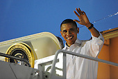 United States President Barack Obama descends Air Force One after touching down at Hickam Air Force Base in Honolulu, Hawaii on Wednesday, December 22, 2010.  After a brief delay with matters in Washington, Obama finally starts his vacation. .Credit: Cory Lum / Pool via CNP